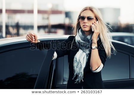 Beautiful business woman on phone in automobile Stock photo © dash
