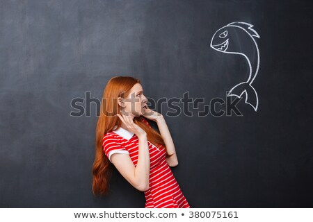 Stock photo: Cute afraid woman scared of shark drawn on chalkboard background