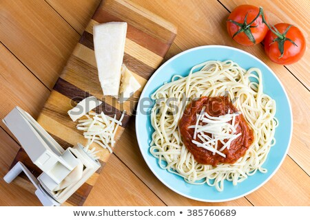 Gruyere cheese and spaghetti next to pasta press Stock photo © ozgur
