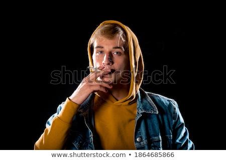 fiatal · modern · stílusú · macsó · férfi · pózol · stúdiófelvétel - stock fotó © zurijeta