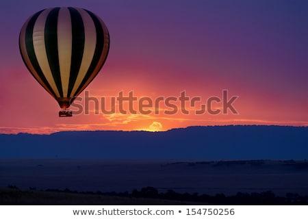 Stock fotó: Léggömbök · nap · repülés · város · naplemente · film