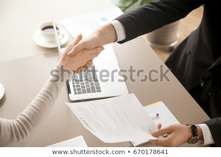 Businesswoman accepting the terms of agreement Stock photo © stevanovicigor