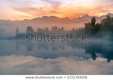 morning lake with mountain before sunrise Stock photo © Mikko