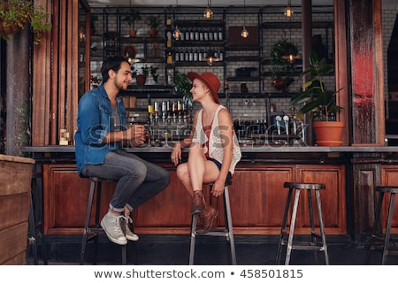 vertical image of woman with man in cafe stock photo © deandrobot