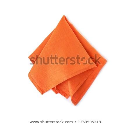 Gevouwen oranje servet weefsel doek textiel Stockfoto © Digifoodstock