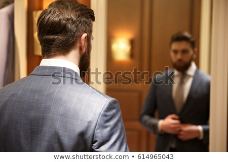 View from back of bearded man looking at the mirror Stock photo © deandrobot