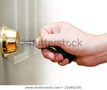 Business people holding key in front of keyhole. Stock photo © RAStudio
