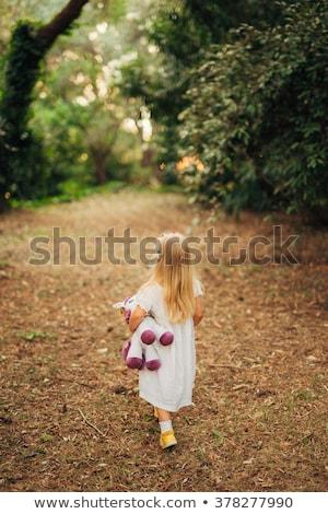 Mooi meisje lopen beneden bos weg eenzaamheid Stockfoto © tekso