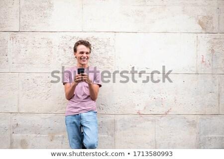 Photo stock: Jeune · homme · téléphone · mur · discothèque · foule