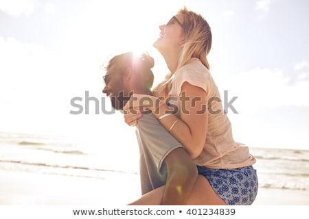 Portré fiatalember derűs barátnő tengerpart napos idő Stock fotó © wavebreak_media