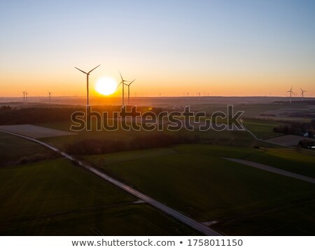 Windturbines in sunrise Stock photo © 5xinc