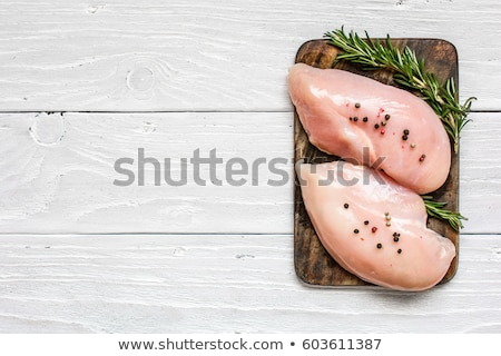 raw chicken meat fillet on wooden background top view stock photo © yelenayemchuk