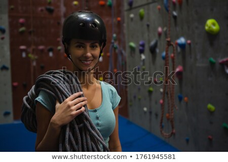 Portrait of athletes in sports helmet carrying ropes at exercise class Stock photo © wavebreak_media