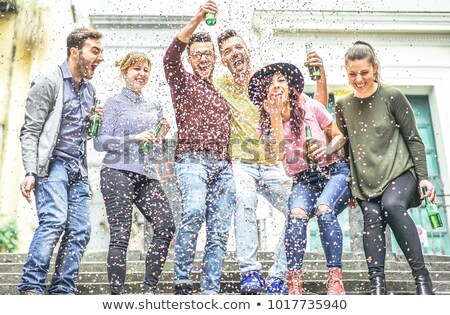 Group of friends making party outdoor with confetti and beers -  Stock photo © DisobeyArt