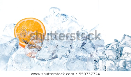 cocktail with ice cubes and orange Stock photo © artjazz