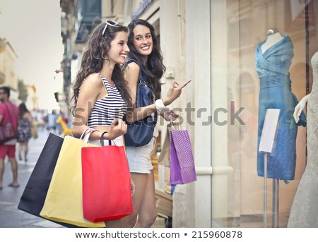 two girls shopping in market stock photo © is2