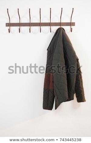 Chaud vêtements suspendu crochet blanche Photo stock © wavebreak_media