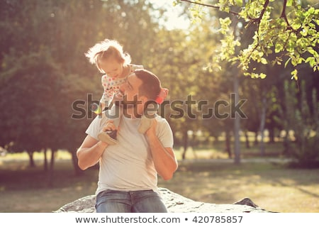 Man with baby in park Stock photo © IS2