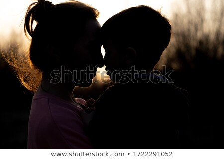 Woman holding child on beach stock photo © IS2