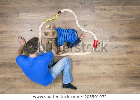 father son play with christmas present stock photo © is2