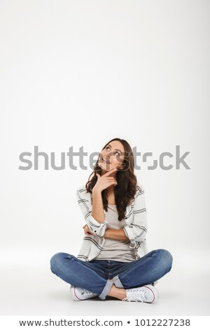 Full-length portrait of pleased woman in casual clothes sitting  Stock photo © deandrobot