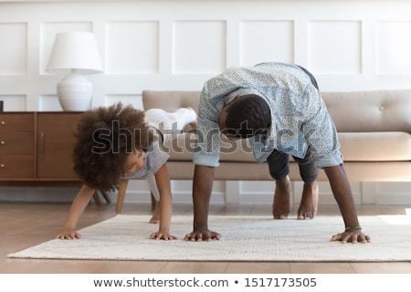 older man doing pushups indoors stock photo © is2