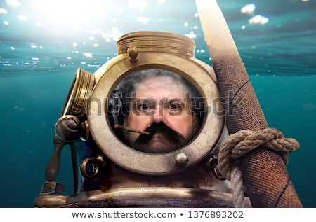 A man in a suit smoking under the water Stock photo © IS2
