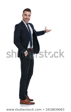 happy businessman with hand in pocket greeting looks to side Stock photo © feedough