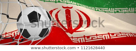 soccer ball in goal net against digitally generated iranian national flag stock photo © wavebreak_media