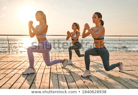 three friends doing sport activities near the sea Stock photo © diego_cervo