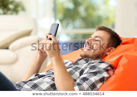 Young boy using cellular phone Stock photo © monkey_business