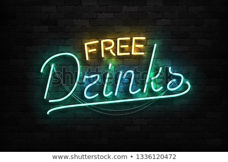 neon sign on a brick wall   free drinks stock photo © zerbor