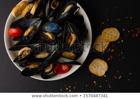 Tomato soup in black bowl with crisp bread  Stock photo © dash