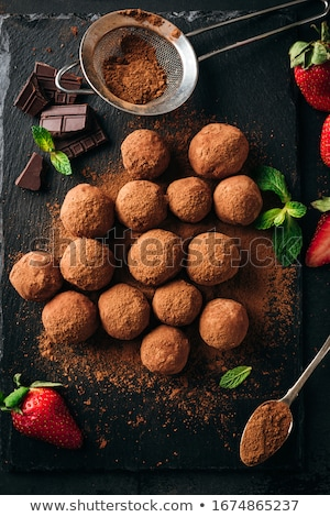 chocolate candy truffles fall out stock photo © illia