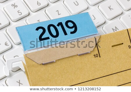 a brown file folder labeled with 2019 stock photo © zerbor