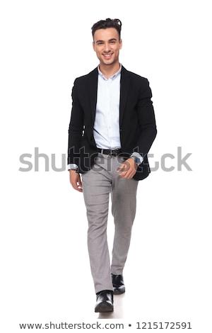 Gülen işadamı siyah takım elbise gri pantolon Stok fotoğraf © feedough