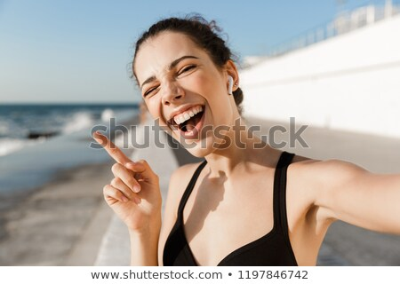 close up laughing young sportswoman at the seaside stock photo © deandrobot