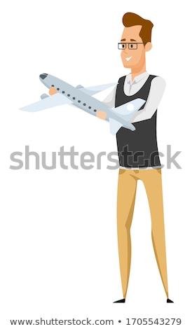 male airplane pilot. Model aircraft in hand Stock photo © studiostoks