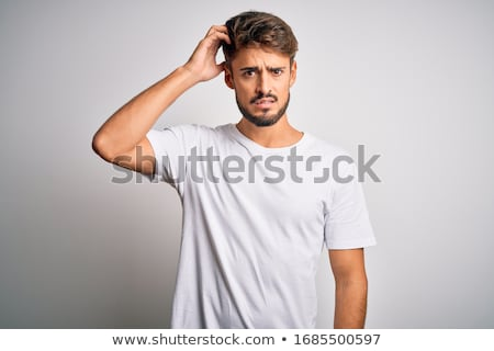 portrait if a confused man stock photo © deandrobot