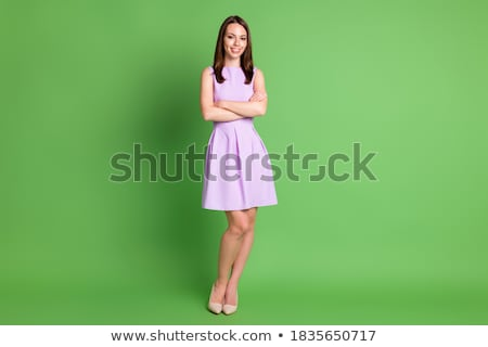 confident businesswoman stands with arms folded and legs crossed Stock photo © feedough