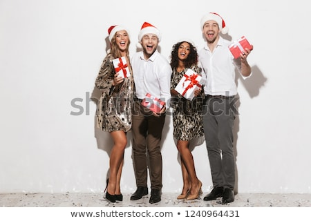 Group of happy friends dressed in red hats Stock photo © deandrobot