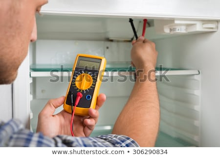 Serviceman Checking Temperature Of Refrigerator Stock photo © AndreyPopov
