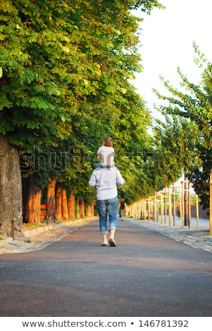 Stock photo: Father Carrying Son With Autumn Leaves In City