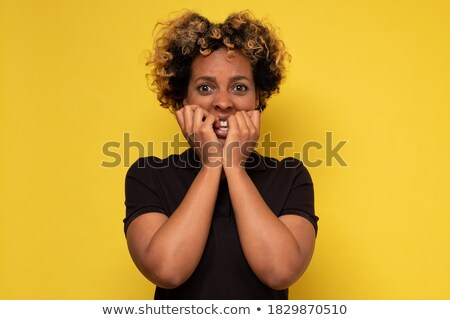 Worried Young African American Woman Biting Nails For Sadness Anxiety Stock photo © diego_cervo