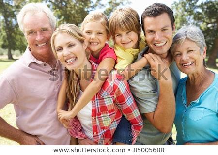 Familienbild schließen Baum Großeltern Schule Kinder Stock foto © Lopolo
