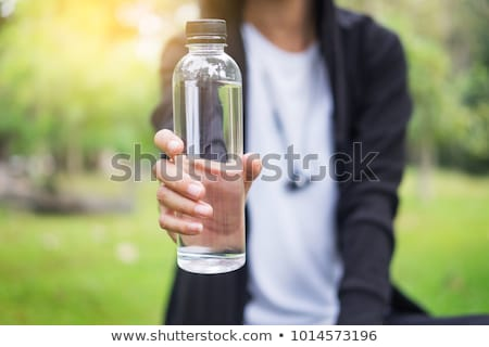 man with bottle of water stock photo © pressmaster