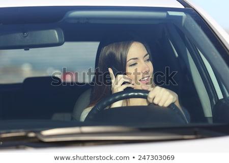 smile businesswoman sitting inside car talking on cellphone stock photo © andreypopov