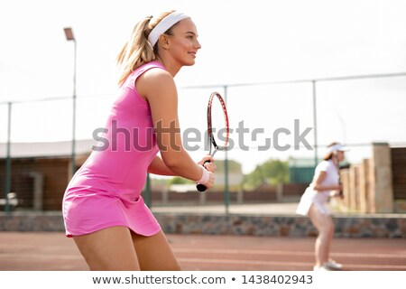 Young fit woman in pink sports dress with racket Stock photo © pressmaster