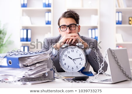 Busy employee chained to his office desk Stock photo © Elnur