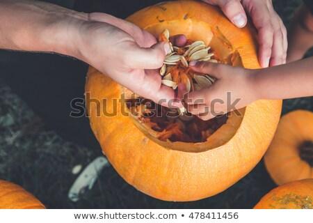 Közelkép kéz kés sütőtök férfi halloween Stock fotó © Illia